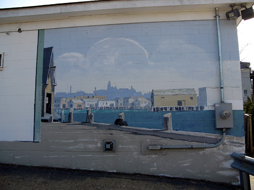 And, moving farthest to the right, the end of the building! Look how the artist has created the feeling that you are peering around the corner of the building, standing on the pier looking at Gloucester in the distance!